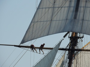 PRIDE of BALTIMORE crew on a main mast spar.