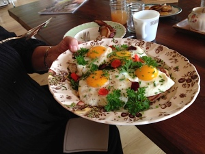 Easy over eggs on corn fritters. Photo by R.E.